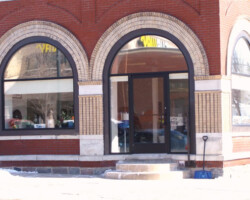 This is an example of a building being restored back to the original sized openings from the 1800′s