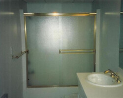 This above picture is a Glassource semi-frameless Highlight tub slider. Gold Metal with obscure (pattern 62) glass.