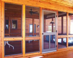 All storms and screens are generally repairable, if not we are here at Charlevoix Glass to build you a new one. We also do full screen porches with storm options to the full custom enclosures as pictured above