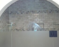 """waved pattern at the top with sandblasted door and panels on 1/2"""" European frameless shower door system"""
